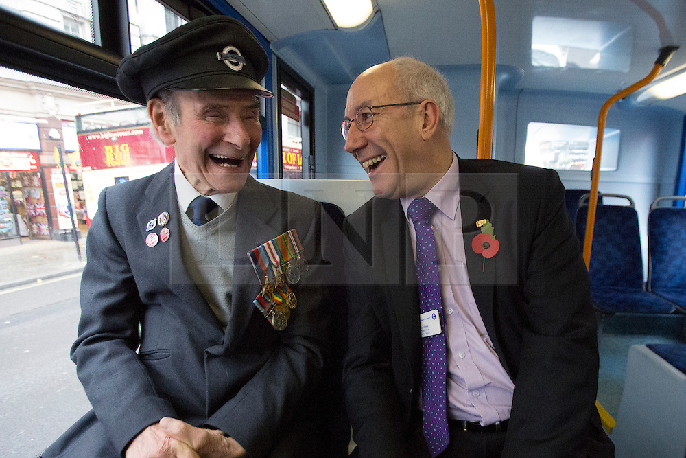 © licensed to London News Pictures. London, UK 26/10/2012. Transport for London's Leon Daniels chatting with an ex-WWII soldier and ex-bus driver on a bus wrapped in the poppy design to highlight the Comrades' role in the Remembrance Sunday Parade and mark TfL's activities to raise awareness of the sacrifices made by London's service men and women. Photo credit: Tolga Akmen/LNP