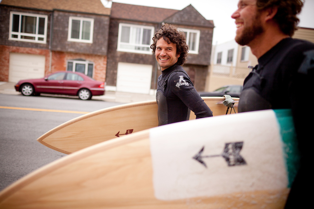 Danny Hess, right, who specializes in making custom surfboards out of sustainable wood, walks with Josh Duthie, left, for a surf session at Ocean Beach, in San Francisco, Ca., on Wednesday, July 6, 2011.