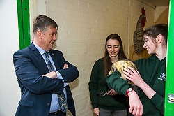Pictured: Kieth Brown meets Zoe White holding Zak rgw Chinchilla and Kirsty McGoff holding Edgar the Ferre<br /> <br /> Cabinet Secretary for Economy, Jobs &amp; Fair Work Keith Brown visited Gorgie City Farm today  to mark their accreditation as the 800th Living Wage employer in Scotland. Mr Brown met Josiah Lockhart, CEO and undertook a short tour of the farm, celebrating their accreditation and promoting the Living Wage more generally. The Scottish Government has set a target of reaching 1,000 Scottish-based Living Wage Accredited Employers by autumn 2017. While at the farm Mr Brown met Maia Gordon, Kirsty McGoff (17) and Zoe White (18), who have benefited from the living wage, and George Ellis, chair of the farm's board of directors<br /> Ger Harley | EEm 18 May 2017