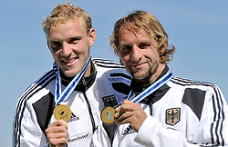MARTIN HOLLSTEIN & ANDREAS IHLE (BOTH GERMANY) POSE WITH THEIR GOLD MEDALS IN MEN'S K2 1000 METERS FINAL A RACE DURING 2010 ICF KAYAK SPRINT WORLD CHAMPIONSHIPS ON MALTA LAKE IN POZNAN, POLAND...POLAND , POZNAN , AUGUST 21, 2010..( PHOTO BY ADAM NURKIEWICZ / MEDIASPORT ).