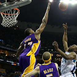 April 28, 2011; New Orleans, LA, USA; New Orleans Hornets power forward Carl Landry (24) shoots over Los Angeles Lakers center Andrew Bynum (17) during the fourth quarter in game six of the first round of the 2011 NBA playoffs at the New Orleans Arena. The Lakers defeated the Hornets 98-80 to advance to the second round of the playoffs.   Mandatory Credit: Derick E. Hingle