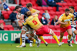 Bristol Rugby Number 8 James Phillips is tackled by Scarlets Lock Jack Jones - Mandatory byline: Rogan Thomson/JMP - 22/11/2015 - RUGBY UNION - Ashton Gate Stadium - Bristol, England - Bristol Rugby v Scarlets Premiership Select - B&I Cup.