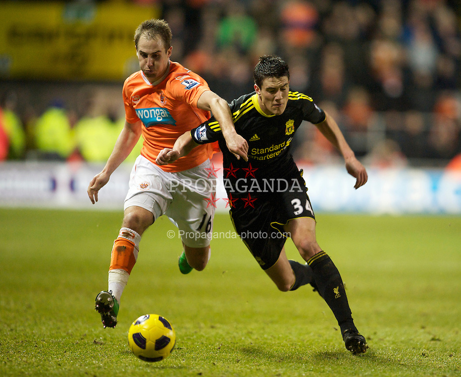 BLACKPOOL, ENGLAND - Wednesday, January 12, 2011: Liverpool's Martin Kelly and Blackpool's Luke Varney during the Premiership match at Bloomfield Road. (Photo by David Rawcliffe/Propaganda)