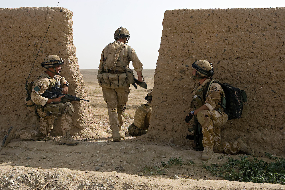 British soldiers of 3rd Battalion The Parachute Regiment search for insurgents after a dawn assault on a compound as part of Operation 'Southern Beast'. Kandahar Province, Afghanistan on the 6th of August 2008.
