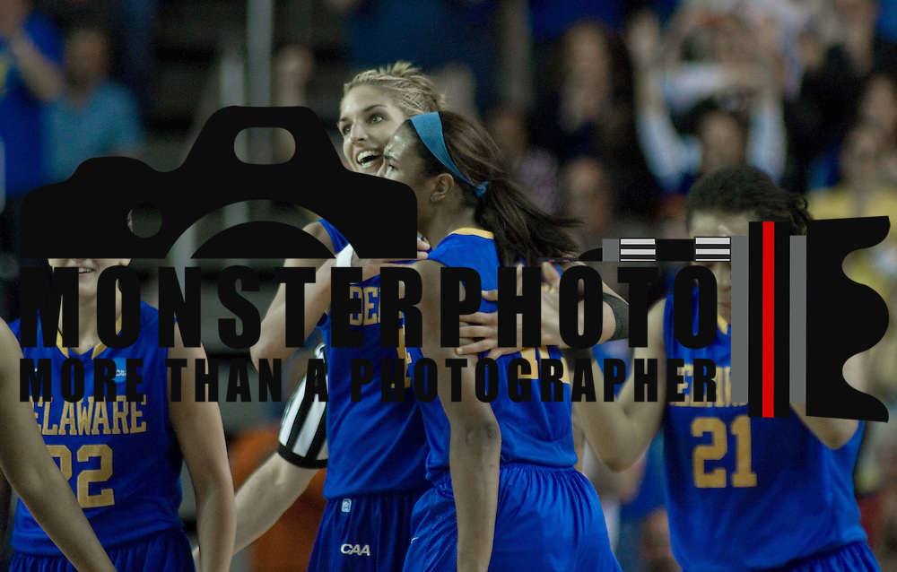 Delaware Forward Elena Delle Donne (11) and Danielle Parker (12) celebrates at the center of the court after No. 6 Delaware upsets No. 3 North Carolina 78-69 in Round Two Women's NCAA tournament Tuesday, March 26, 2013, at the Bob Carpenter Center in Newark Delaware.