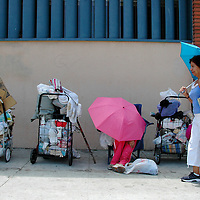 A women gets shade from her umbrella at Arizona Avenue in Santa Monica on Wednesday, June 27, 2007 .