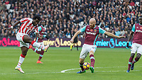 Football - 2016 / 2017 Premier League - West Ham United vs. Stoke City<br /> <br /> James Collins of West Ham with a block from a Wilfred Bony of Stoke City shot at The London Stadium.<br /> <br /> COLORSPORT/DANIEL BEARHAM