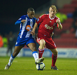 WIGAN, ENGLAND - Monday, March 8, 2010: Liverpool's Dirk Kuyt and Wigan Athletic's Charles N'Zogbia during the Premiership match at the DW Stadium. (Photo by David Rawcliffe/Propaganda)