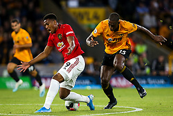 Anthony Martial of Manchester United takes on Willy Boly of Wolverhampton Wanderers - Mandatory by-line: Robbie Stephenson/JMP - 19/08/2019 - FOOTBALL - Molineux - Wolverhampton, England - Wolverhampton Wanderers v Manchester United - Premier League