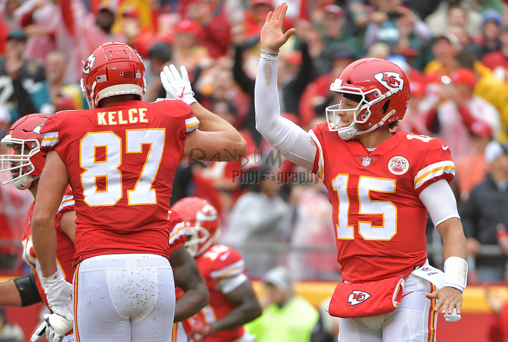 Oct 7, 2018; Kansas City, MO, USA; Kansas City Chiefs quarterback Patrick Mahomes (15) celebrates with tight end Travis Kelce (87) after Mahomes score during the first half against the Jacksonville Jaguars at Arrowhead Stadium. Mandatory Credit: Denny Medley-USA TODAY Sports