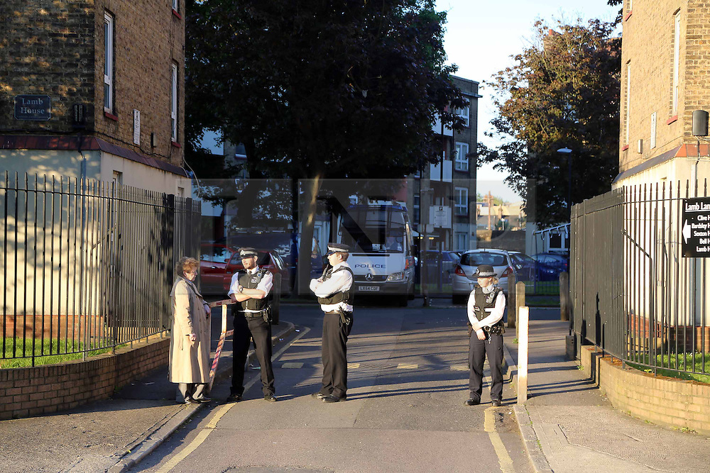 © Licensed to London News Pictures. 25/05/2013. Greenwich, United Kingdom. Metropolitan Police officers search a flat in Clive House on the Lamb Lane estate in Greenwich in the wake of the murder of Drummer Lee Rigby credit : Rob Powell/LNP
