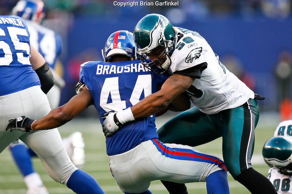 11 Jan 2009: Philadelphia Eagles linebacker Tank Daniels #50 stops New York Giants running back Ahmad Bradshaw #44 during the game against the New York Giants on January 11th, 2009.  The  Eagles won 23-11 at Giants Stadium in East Rutherford, New Jersey.