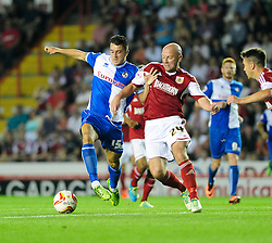 Bristol Rovers' Oliver Norburn is tackled by Bristol City's James O'Connor  - Photo mandatory by-line: Dougie Allward/JMP - Tel: Mobile: 07966 386802 04/09/2013 - SPORT - FOOTBALL -  Ashton Gate - Bristol - Bristol City V Bristol Rovers - Johnstone Paint Trophy - First Round - Bristol Derby