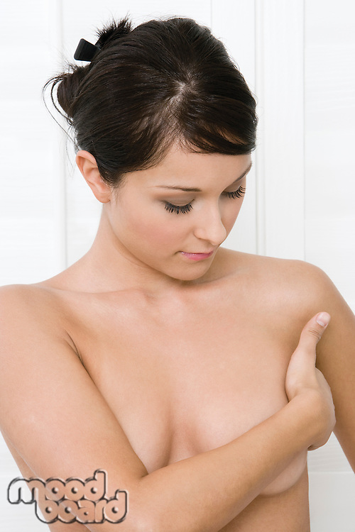 Woman examining breast