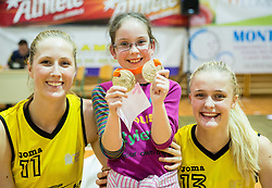 Zala Lesek of Athlete Celje and Larisa Ocvirk of Athlete Celje with fan after winning during basketball match between ZKK Athlete Celje and ZKK Triglav in Finals of 1. SKL for Women 2014/15, on April 20, 2015 in Gimnazija Celje Center, Celje, Slovenia. ZKK Athlete Celje became Slovenian National Champion 2015. Photo by Vid Ponikvar / Sportida