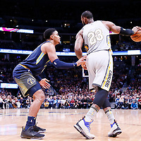 07 March 2018: Denver Nuggets guard Gary Harris (14) defends on Cleveland Cavaliers forward LeBron James (23) during the Cleveland Cavaliers 113-108 victory over the Denver Nuggets, at the Pepsi Center, Denver, Colorado, USA.