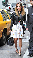 (UK RIGHTS ONLY) Actress Jessica Alba arriving for a meeting at an office in New York, wearing a black leather jacket, black top, silk skirt and a pair of high heels which she forgot to take the tags off... NYC, USA. 03/10/2012<br />