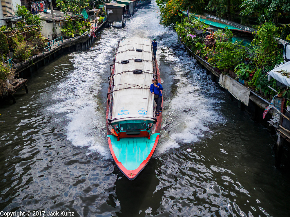 31 MARCH 2017 - BANGKOK, THAILAND: A passenger boat on Khlong Saen Saeb. Bangkok used to be criss crossed by canals (called Khlongs in Thai) but most have been filled in and paved over. Khlong Saen Saeb is one of the few remaining khlongs in Bangkok with regular passenger boat service. Boats and ships play an important in daily life in Bangkok. Thousands of people commute to work daily on the Chao Phraya Express Boats and fast boats that ply Khlong Saen Saeb. Boats are used to haul commodities through the city to deep water ports for export.           PHOTO BY JACK KURTZ