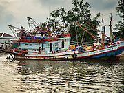 01 OCTOBER 2015 - MAHACHAI, SAMUT SAKHON, THAILAND: A Thai fishing trawler on the Tha Chin river in Mahachai, one of Thailand's largest fishing ports. Thailand's fishing industry had been facing an October deadline from the European Union to address issues related to overfishing and labor practices. Failure to adequately address the issues could have resulted in a ban on Thai exports to the EU. In September Thai officials announced that they had secured an extension of the deadline. Officials did not say how much extra time they had to meet the EU goals. Thailand's overall annual exports to the EU are between 23.2 billion Thai Baht and 30 billion Thai Baht (US$645 million to US $841 million). Thailand's total fish exports were worth about 110 billion baht in 2014.    PHOTO BY JACK KURTZ