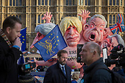 As Prime Minister Theresa May tours European capitals hoping to persuade foreign leaders to accept a new Brexit deal (following her cancellation of a Parliamentary vote), TV journalists (foreground) and and pro-EU Remainers protest with satirical figures of Theresa May, Boris Johnson, Michael Gove and David Davies, opposite the Houses of Parliament, on 11th December 2018, in London, England.
