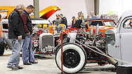 John Skalasi of Dayton (left) and Jeff Bowman of Fairborn look at cars during the KOI Hot Rod Fest Dayton at the Dayton Airport Expo Center in Vandalia, Sunday, March 12, 2012.