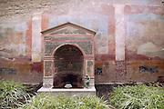The fountain House of the small fountain, Casa Della fontana piccola, the ruins at Pompeii, Campania, Italy under the Vesuvius volcano, July 2006