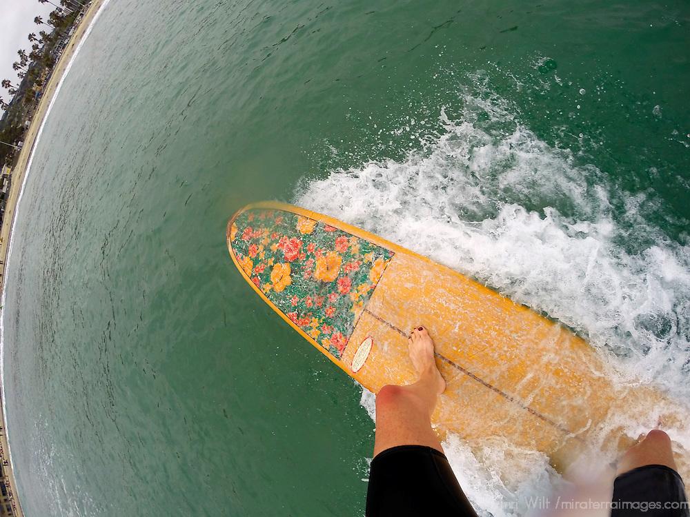 USA, California, San Diego. Longboard Surfing Female POV