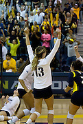 Northern Arizona's outside Hitter Janae Vander Ploeg (Sr.) leads the throws her hands in the air in celebration of NAU's victory over Northern Colorado, Oct. 24, 2015. Ploeg was the one who scored the game winning point during game that ended in five sets. (Photo by David Carballido-Jeans)