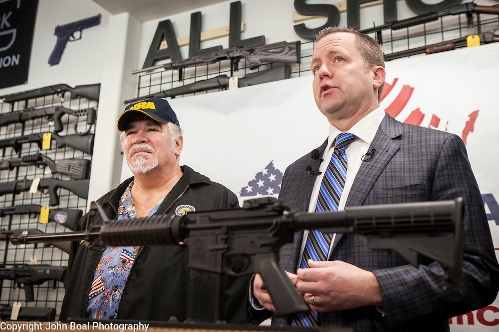 Corey Stewart, right, Chairman of the Board of Supervisors of Prince William County and Virginia Gubernatorial candidate, gave away a Smith & Wesson M&P 15 Sport II, an AR-15 rifle, to Rick Thompson, left, at All Shooters Tactical in Woodbridge, Virginia on Wednesday, January 11, 2017.  The Stewart campaign used the AR-15 giveaway as an opportuntiy to tout Stewart's record on support for the second amendment.  John Boal Photography