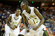 JD Wallace (15) of Dallas Madison reacts after a dunk against Houston Yates during the UIL 3A state championship game at the Frank Erwin Center in Austin on Saturday, March 9, 2013. (Cooper Neill/The Dallas Morning News)