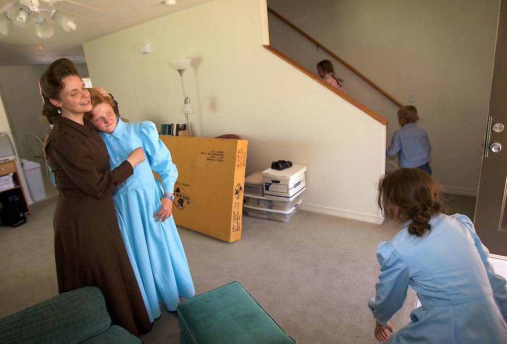 FLDS mother Sarah Barlow Draper hugs her daughter Rebekah (cq) as Danielle looks on and Autumn (cq), and Abram (cq) run upstairs in their home in Abilene, Texas on Monday June 2, 2008. They had reunited with their mother following the court order which released the children back into the custody of their mothers. August MIller/ Deseret News .