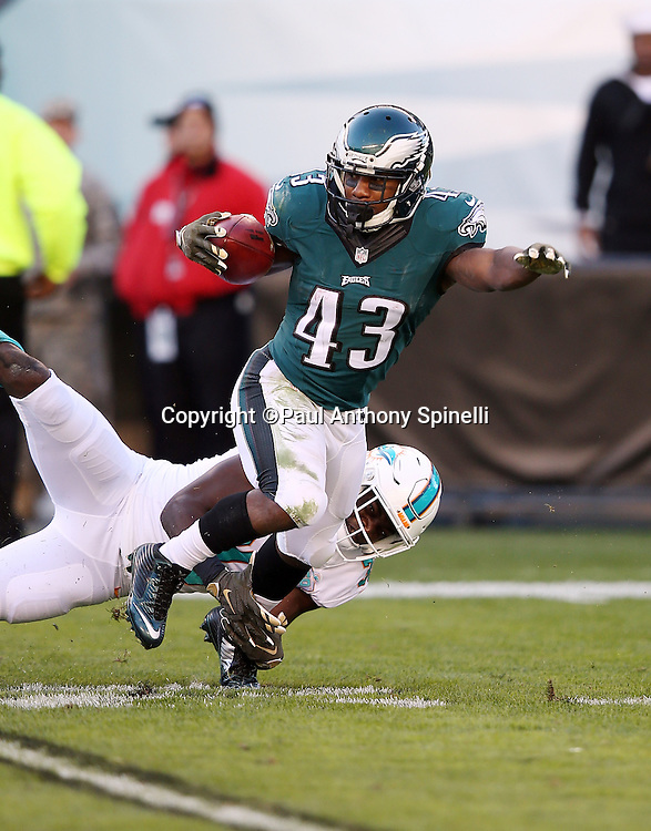 Philadelphia Eagles running back Darren Sproles (43) gets tackled as he returns a second quarter punt to the Eagles 30 yard line during the 2015 week 10 regular season NFL football game against the Miami Dolphins on Sunday, Nov. 15, 2015 in Philadelphia. The Dolphins won the game 20-19. (©Paul Anthony Spinelli)