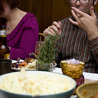 Ron Caruso licks his fingers after sampling  Erin's shallot-ginger glazed cornish hens.