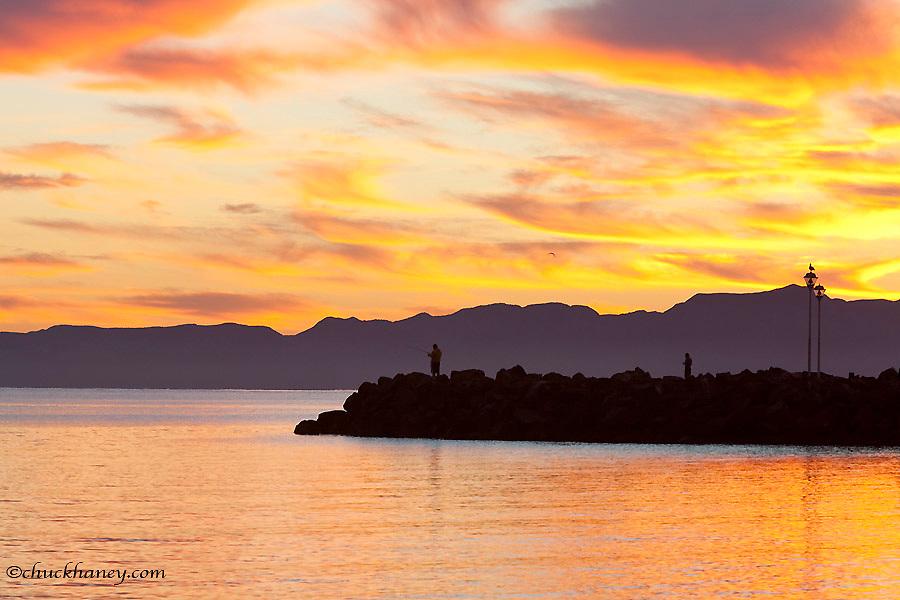 Fishermen along the marina at sunrise in Loreto Mexico