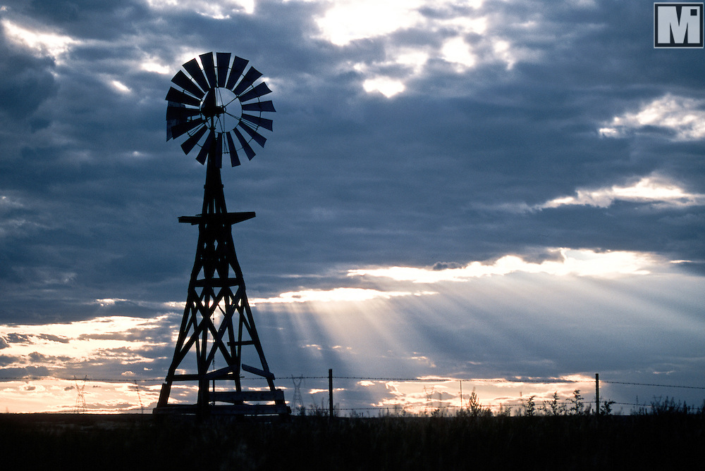 Traditional american water pumping windmill just below Bear Mountain near Hawk Springs, Wyoming.