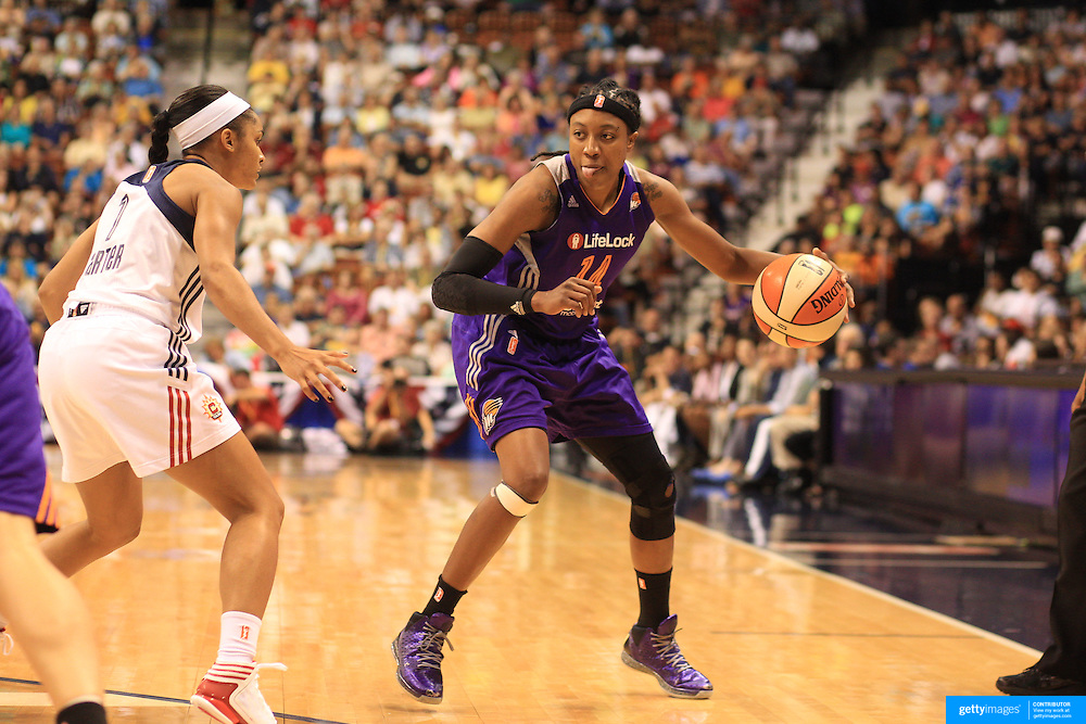 Tan White, Phoenix Mercury, in action during the Connecticut Sun V Phoenix Mercury, WNBA regular season game at Mohegan Sun Arena, Uncasville, Connecticut, USA. 29th June 2013. Photo Tim Clayton