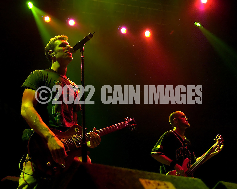 Nick Hexum (L), and  P-Nut, aka Aaron Wills (R), of 311, perform during the Sprite Liquid Mix Tour at the Tweeter Center, Tuesday, August 27, 2002, in Camden, New Jersey. The Sprite Liquid Mix Tour features a fusion of music, street sports, artistic demonstrations, fashion and entertainment. Attendees can participate in full-court basketball, view street-type skaters, BMX bikers, a canvas featuring local urban graffiti artists, an urban fashion show, and a music mixing station. (Photo by William Thomas Cain/photodx.com)