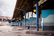 An empty platform on the Bus Terminal of La Paz. During elections period in  Bolivia, the country faces several restrictions, like no alcohol for sale 48 hours before and 12 after the election; no public gatherings, shows of any kind until the political parties made their speeches on the election night; its completely forbidden the circulation of any vehicles, private or governmental except with the permit from the Electoral Tribunal, which means it would be basically no cars, buses or anything circulating in the city; no long distance buses, the terminal will be close from Saturday until Monday and even flights will not be allowed except the ones leaving the country or the international ones doing stop-over. It is a completely shut down of the country.