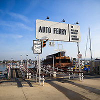 Photo of Balboa Island Auto Ferry sign and entrance in Newport Beach California. The Balboa Island Ferry has been operating since 1919 and carries people and cars from Balboa Peninsula to Balboa Island across Newport Harbor (Newport Bay).