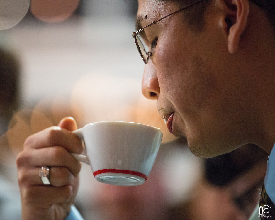 Judge Chris Gaoiran of Bellano Coffee in Santa Clara tastes a cappuccino prepared by Justin Williams, 25, of Front Café in San Francisco during the 2nd Annual Mock Barista Competition and Brewer's Cup at San Pedro Square Market in San Jose, California, on February 21, 2013.  (Stan Olszewski/SOSKIphoto)