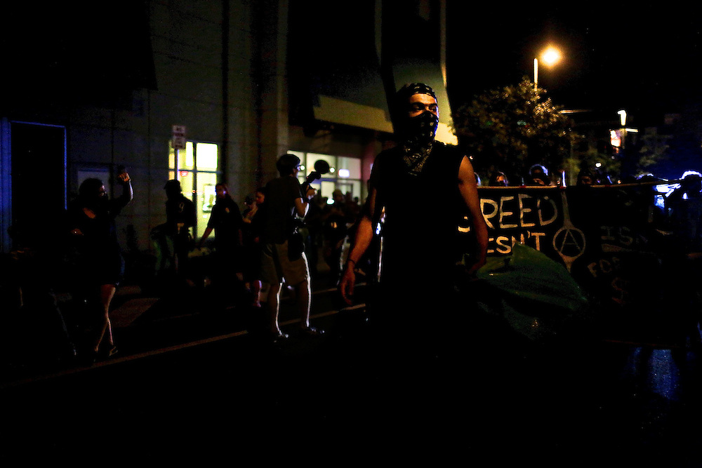 Protestors form a black bloc and fill the streets in an unscheduled silent march against police brutality during the 2012 Republican National Convention in Tampa, Fla. on Aug. 29, 2012.