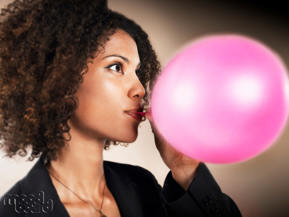 Businesswoman Blowing up Balloon