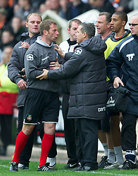 WREXHAM, WALES - Monday, May 7, 2012: Wrexham's assistant manager Billy Barr clashes with Luton Town's manager Paul Buckle during the Football Conference Premier Division Promotion Play-Off 2nd Leg at the Racecourse Ground. (Pic by David Rawcliffe/Propaganda)