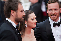 Director Justin Kurzel, actress Marion Cotillard and actor Michael Fassbender at the gala screening for the film Macbeth at the 68th Cannes Film Festival, Saturday 23rd May 2015, Cannes, France.