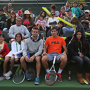 March 1, 2014, Palm Springs, California: <br /> ATP players Tim Smyczek and Dusan Lajovic pose with kids during Kids Day at the Indian Wells Tennis Garden sponsored by the Coachella Valley National Junior Tennis and Learning Network.<br /> (Photo by Billie Weiss/BNP Paribas Open)