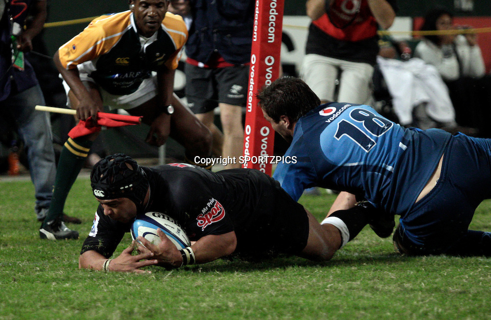 Adrian Jacons scores a try during the Super 15 match between the Sharks and the Bulls played in Durban on the 21 May 2011..Photo by: SPORTZPICS