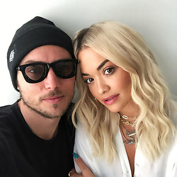 """Rita Ora releases a photo on Twitter with the following caption: """"""""Love working with this cat always a pleasure 🕶📸"""""""". Photo Credit: Twitter *** No USA Distribution *** For Editorial Use Only *** Not to be Published in Books or Photo Books ***  Please note: Fees charged by the agency are for the agency's services only, and do not, nor are they intended to, convey to the user any ownership of Copyright or License in the material. The agency does not claim any ownership including but not limited to Copyright or License in the attached material. By publishing this material you expressly agree to indemnify and to hold the agency and its directors, shareholders and employees harmless from any loss, claims, damages, demands, expenses (including legal fees), or any causes of action or allegation against the agency arising out of or connected in any way with publication of the material."""