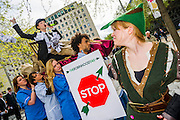 Protestors complaining about the use of tax havens, banks support for coal mining and the lack of a robin hood tax on financial transactions  (pictured) gather outside the Festival Hall as Barclays plc shareholders queue for the bank's AGM. Southbank, London, UK 24 April 2014.