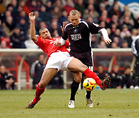 Photo: Leigh Quinnell.<br /> Nottingham Forest v Swansea. Coca Cola League 1. 11/02/2006. Nottingham Forests Julian Bennett challenges Swanseas Lee Trundle.