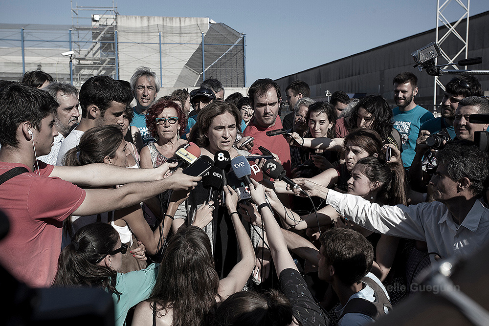 "The newly elected Mayor of Barcelona and social activist, Ada Colau  who attended the protest to give o give her support answers question to the media during the protest organized by""Tancarem el CIE"" to get to government to close the Immigration detention center permanently.   Barcelona 20/06/2015"